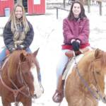 Nikki riding T and Gypsy and I in the snow.